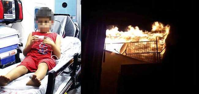 Yangında mahsur kalan çocuğu kurtardı