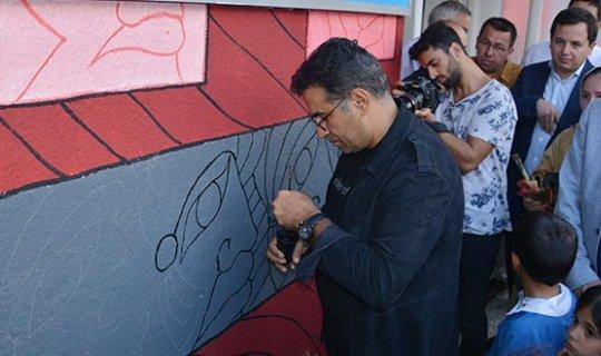 Korkuteli'nde okul duvarı sanatla buluştu