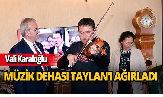 Müzik dehası Taylan  Vali Karaloğlu'nu ziyaret etti