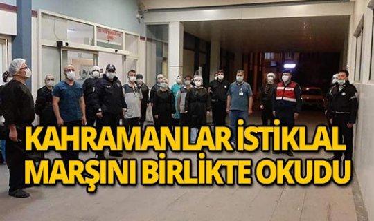 Sağlık çalışanları ve polis İstiklal Marşı'nı birlikte okudu