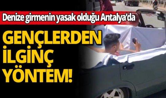 Deniz girmenin yasak olduğu Antalya'da gençlerin ilginç çözümü
