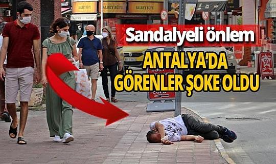Antalya haber: Esnaf, sarhoş adamın imdadına yetişti