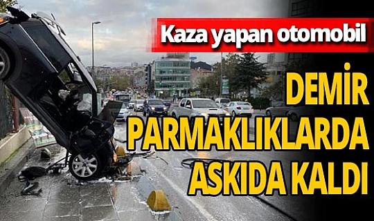 Kadıköy'de kaza yapan otomobil demir parmaklıklarda askıda kaldı