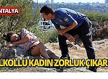 Falezlerdeki alkollü kadın, polisi uğraştırdı
