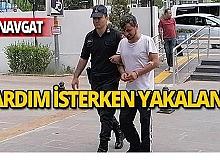 Polisten yardım istedi, hırsızlıktan yakalandı