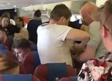 Uçakta rezalet çıkaran yolcuya 'bantlı' müdahale
