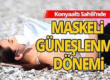 Antalya'da maskeli güneşlenme dönemi