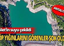 Antalya'da Doyran Göleti'nin suyu çekildi, çöp yığınları ortaya çıktı