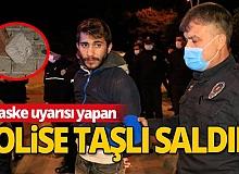 Maske takmaları için uyaran polise taşla saldırdılar