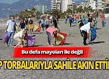 Örnek davranış! Yerleşik yabancılar sahilde çöp topladı