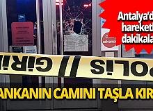 Önce kaldırım taşıyla bankanın camını kırdı, sonra teslim oldu