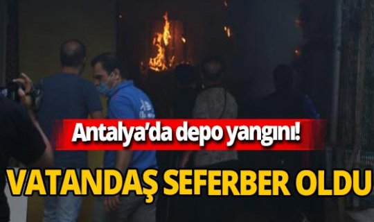 Antalya'da çıkan yangına vatandaş sulama hortumuyla müdahele etti!