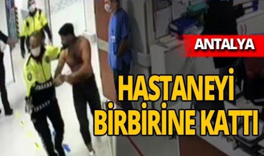 Finike'de polise direnen şahıs hastanenin cam kapısını tekmeledi