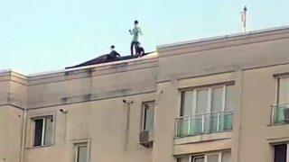 Sosyal medya uğruna 11 katlı binanın çatısında dans ettiler