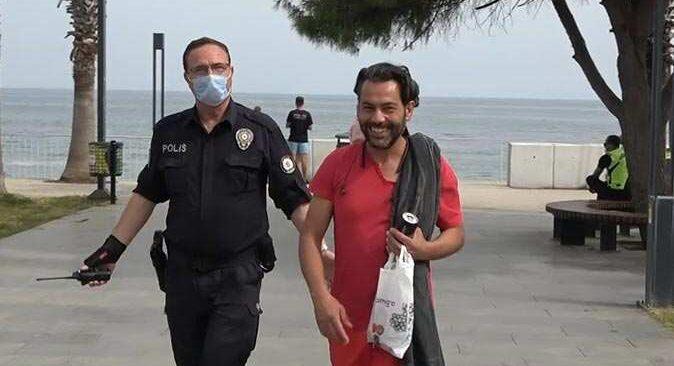Antalya'da sokağa çıkma kısıtlamasında plaj havlusu ve şortu ile yakalandı, tavırları şaşırttı