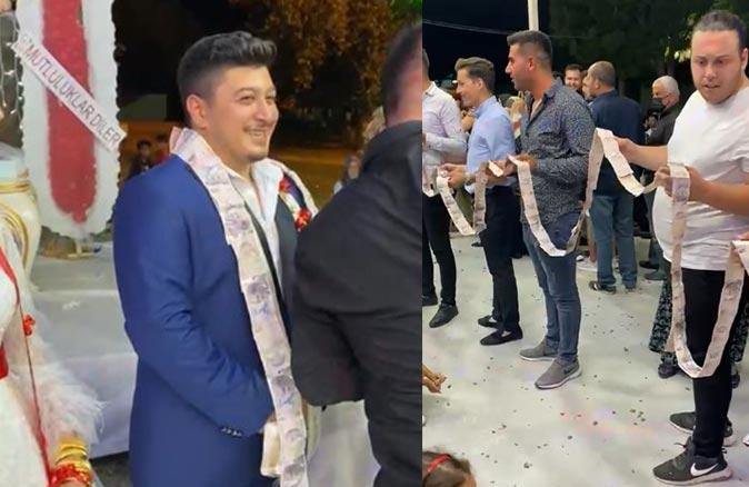 Antalya'da 5 liralardan oluşan 50 metrelik parayı damada taktılar