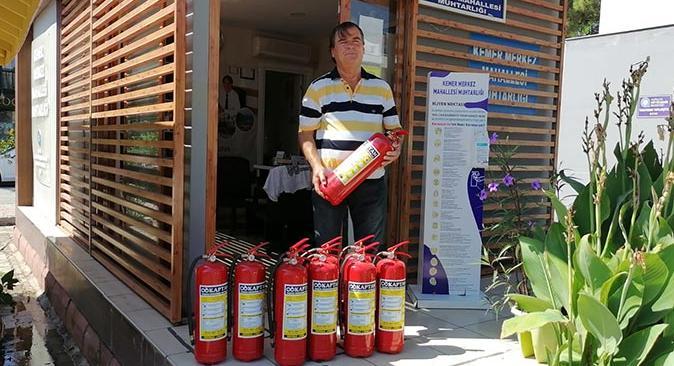 Kemer Belediyesi'nden muhtarlara yangın tüpü desteği